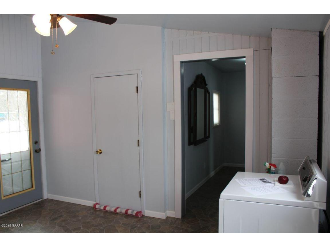 11. Laundry room & entrance to greenhous