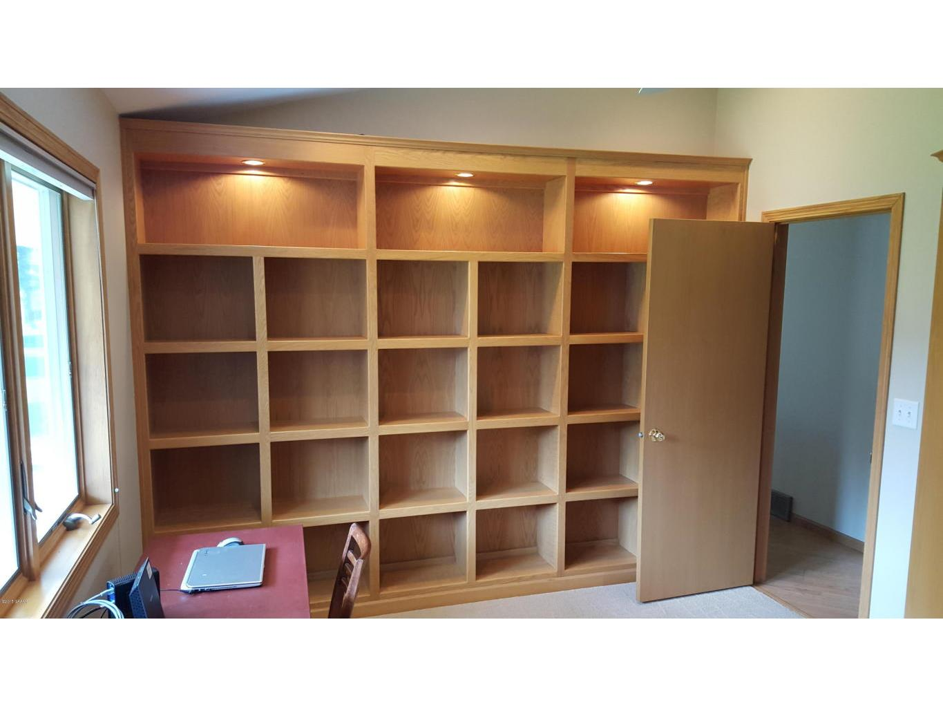 furey office bedroom with shelving and M