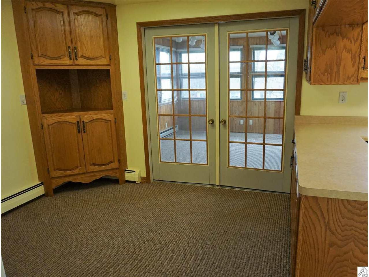 Eat In area of the kitchen that opens to the 4 Season room , back deck, and the attached garage.