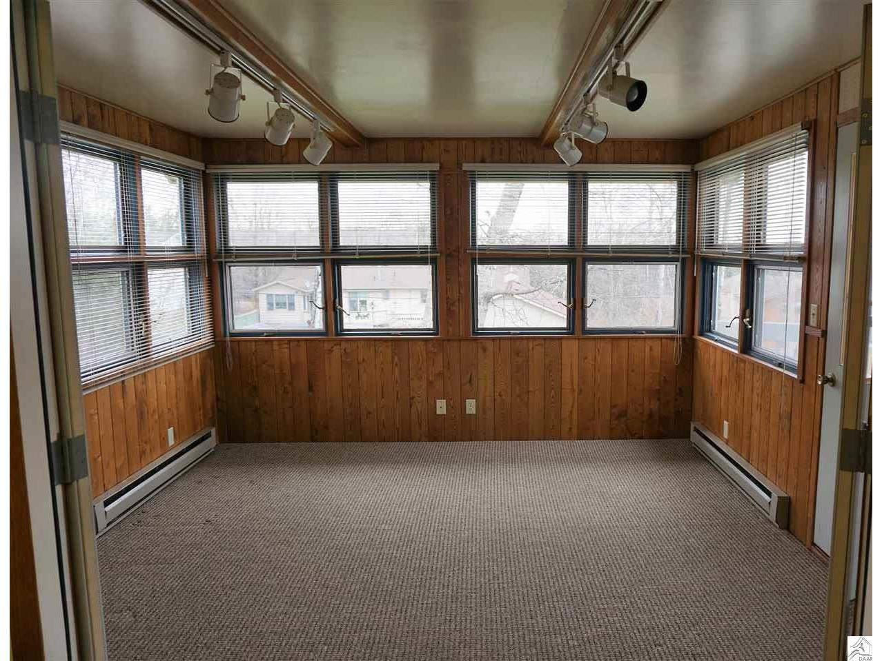 Right off the kitchen is this great added space with door to the deck..