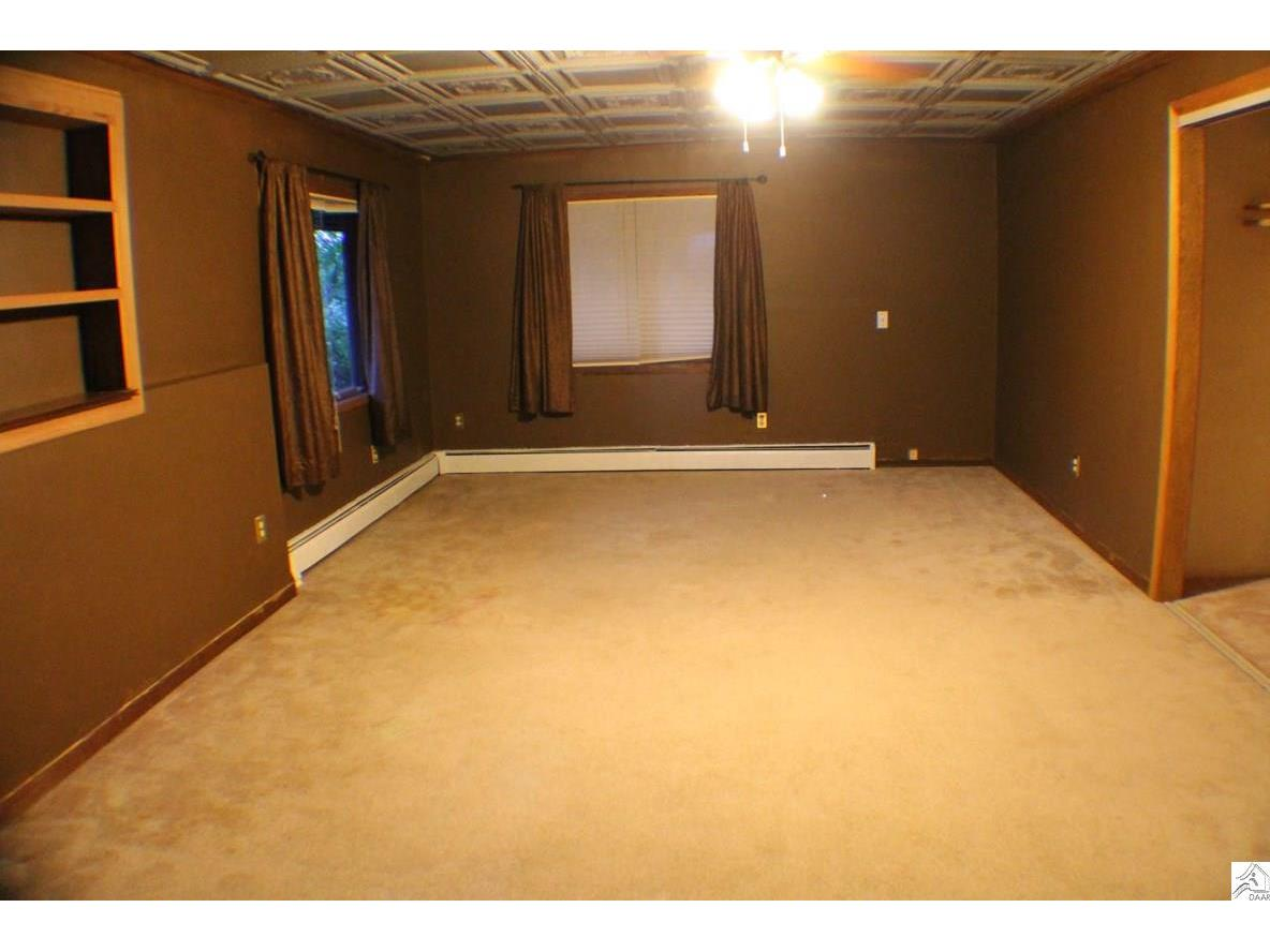 Bed 4 of 4 on lower level is HUGE with antique tin ceilings, large closet