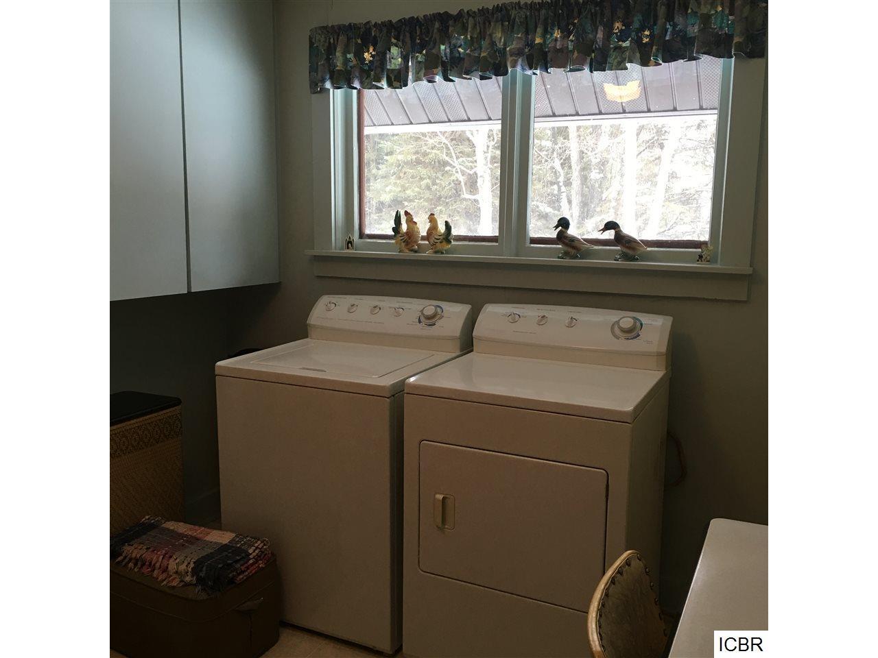 Main Floor Laundry between breezeway & kitchen