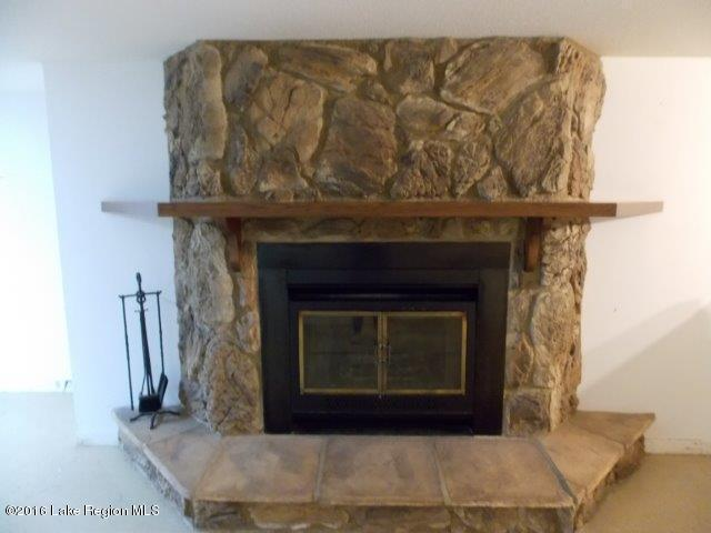 wood burning fireplace in lower level
