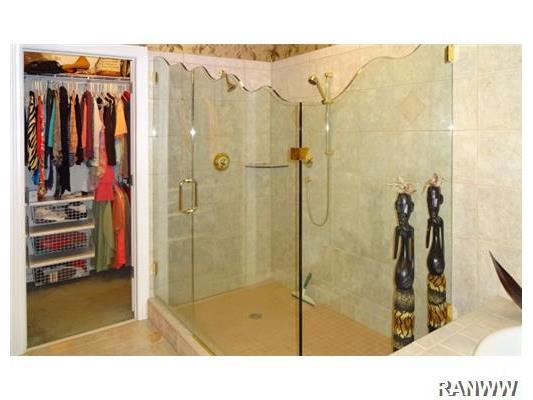 Master Bath/Spa. Beautiful glass shower, huge walk in closet, jetted tub, vanity with wine cooler, and separate toilet room in the fabulous bath