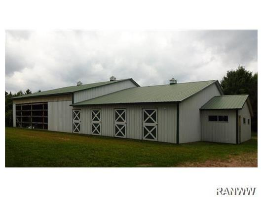 Stable/Barn. 45x90 barn with 6 stalls, large open area, tackroom, plus a workshop with insulated walls and concrete floor.  Approx 5 acres is currently fenced with 3-strand braided wire.