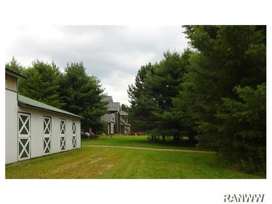 Other. View of home from stable.  There is a separate driveway to the barn, barn has water and electric service too.