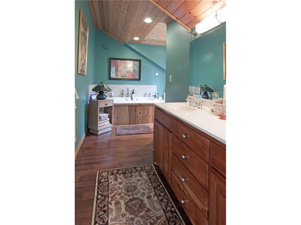 Master bath with soaking tub & tiled shower and double sink vanity.