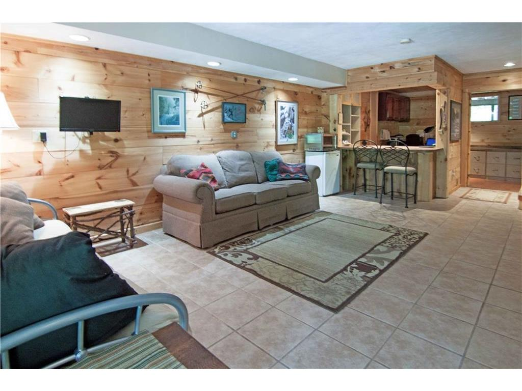 In-floor heated lower level family room with bar/office nook.
