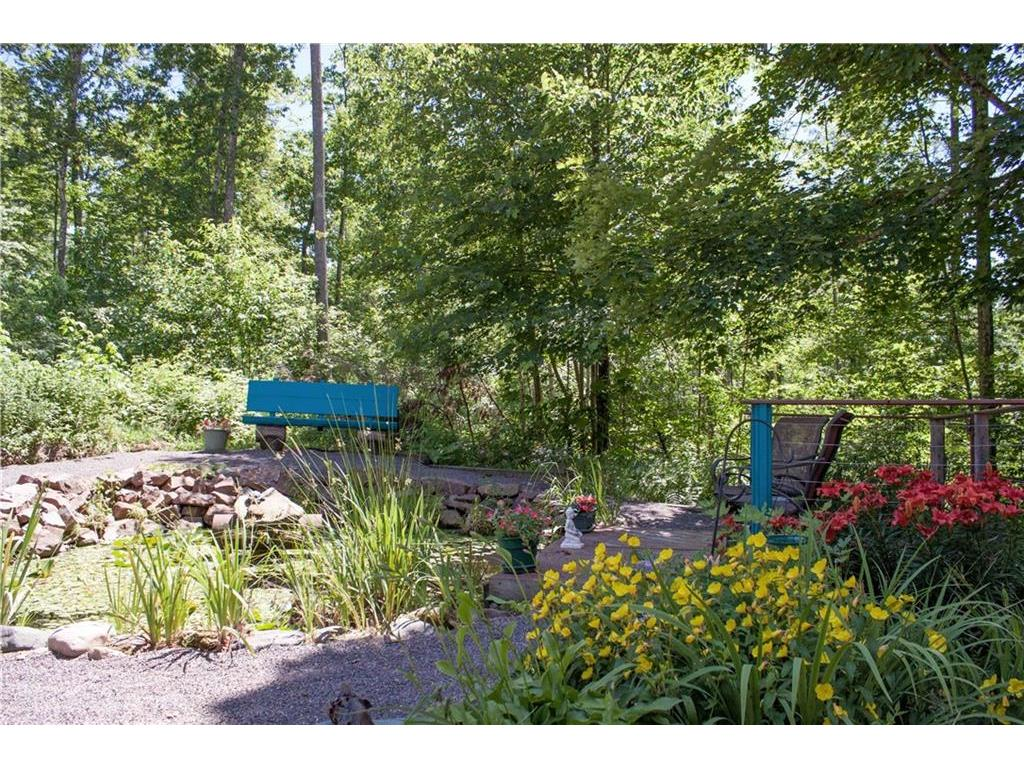 Beautiful perennials and pond with lots of sitting areas.