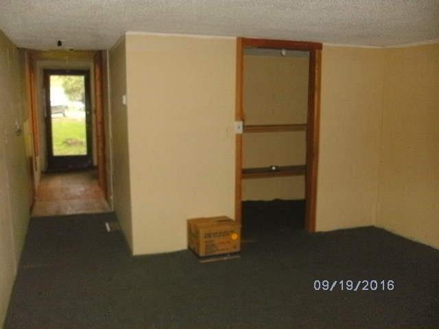 Separate structure next to house was used for third bedroom and second bath. Use as an office-studio or man cave!