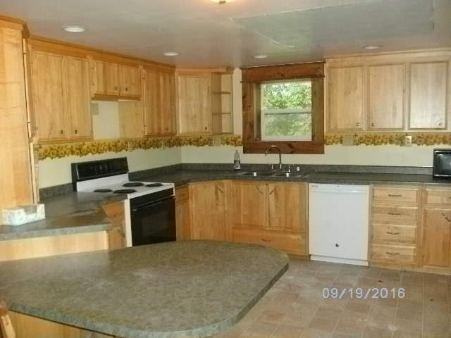 updated kitchen with custom cabinets and new flooring