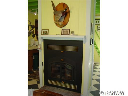Exterior Front. Efficient wood burner with vents and fans to both lower and upper level.  Seller says once it s fired up easily heats cabin even when -20