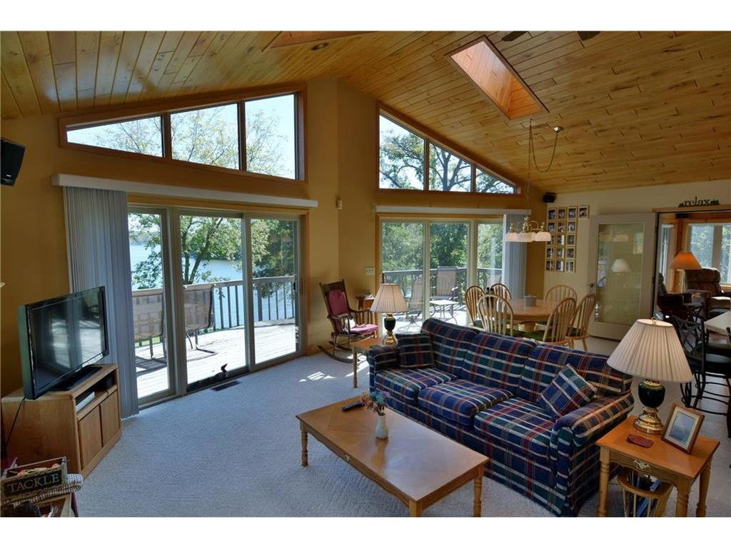 Living Room, skylights and lakeside deck