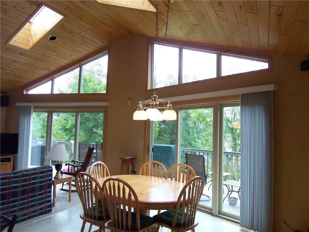 Dining room area with skylights