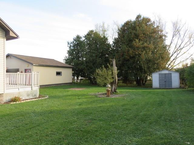Side yard with garden area and play area.