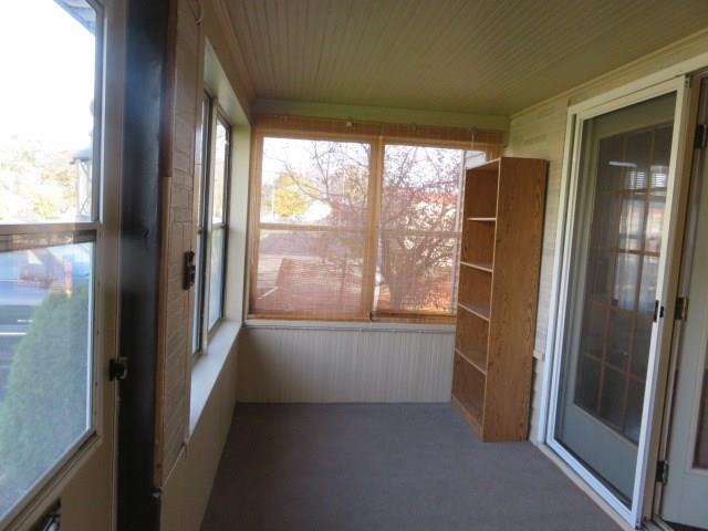 Enclosed Front Porch.