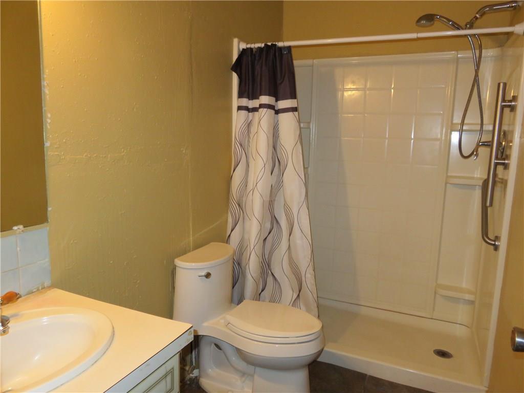 Main bath has oversized shower stall.