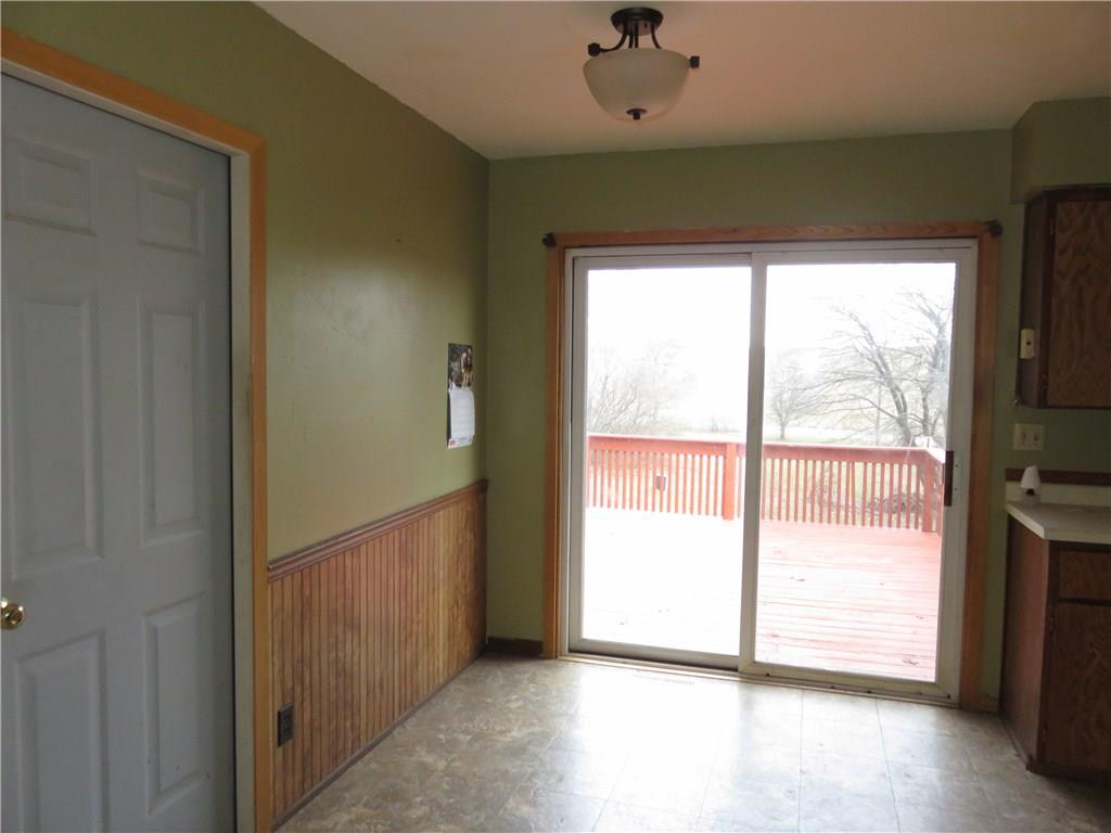 Dining area with sliding glass doors to large rear deck.