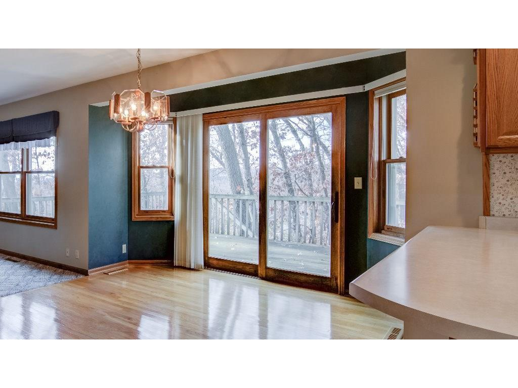 Glass doors that walk out to deck overlooking wooded backyard