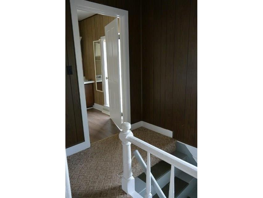 Upstairs landing at top of steps leading into bath.  Convenient for everyone