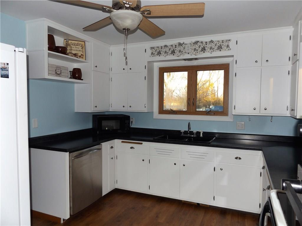 new counter top, refurbished cabinets, & new flooring