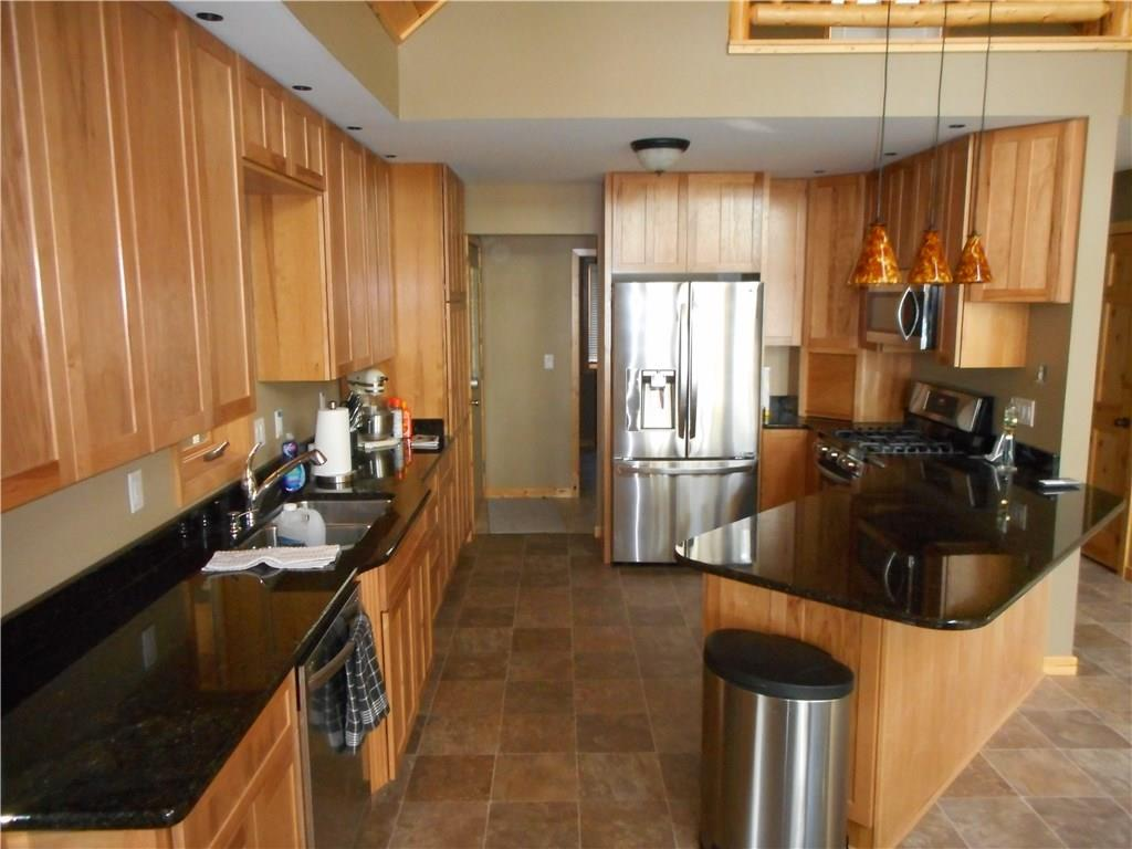 Kitchen with hard surface counters and stainless LG appliances, including gas range.