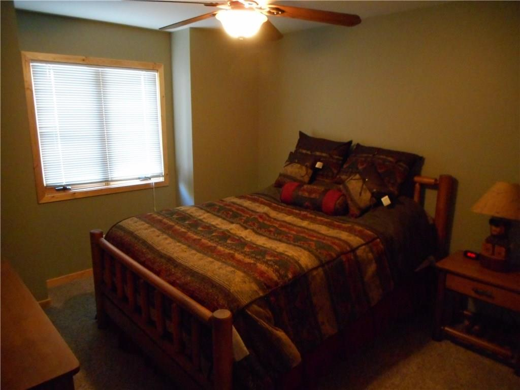 Master Bedroom: has walk out to composite decking over looking lake, walk in closet and master bath.