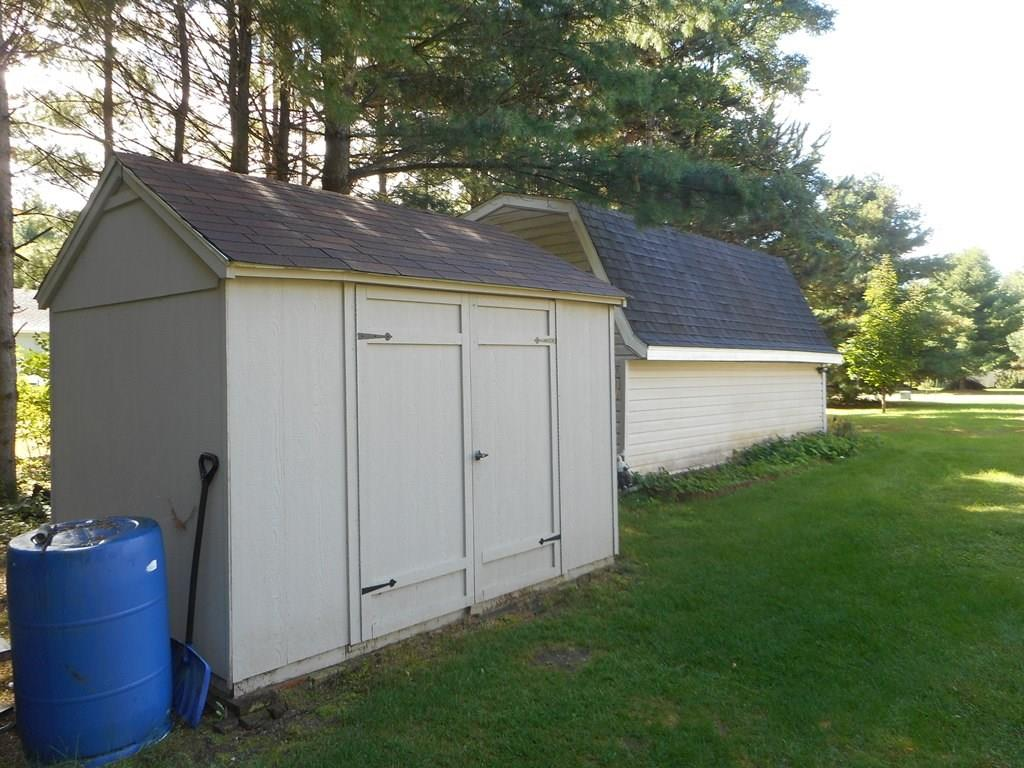 Two ample size sheds are included to store summer/winter lawn equipment, and even set up shop