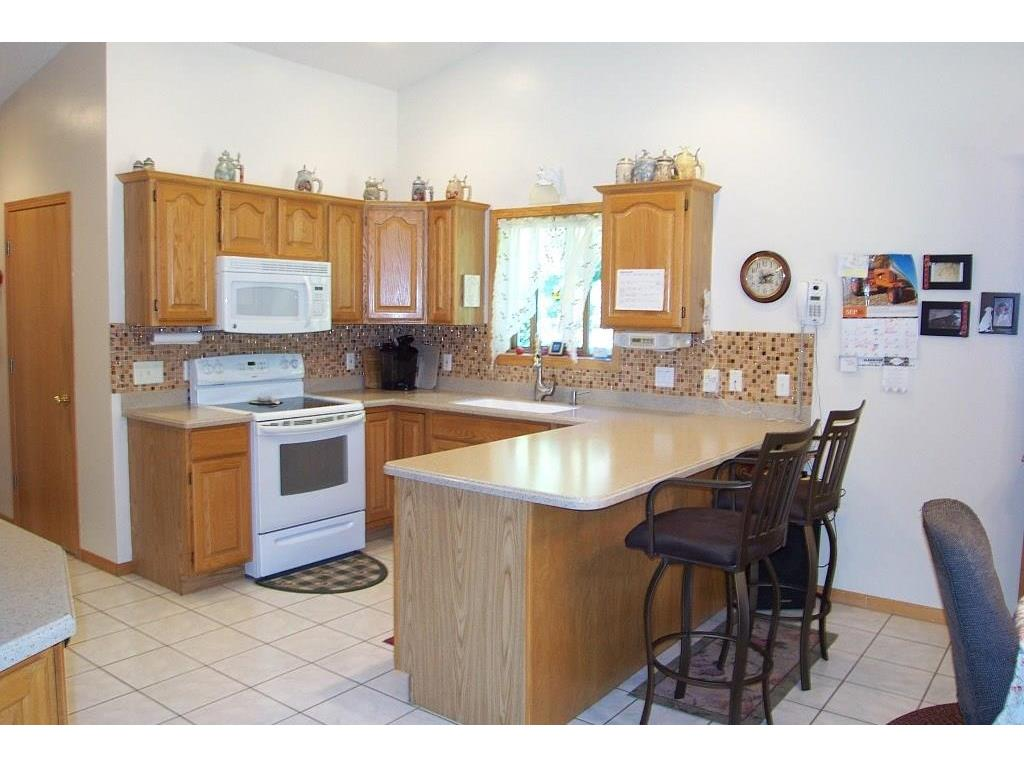 Breakfast counter seating.  All appliances included and a hallway pantry complete this great area.