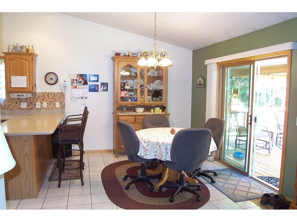 Dining room that leads to composite deck in the back yard