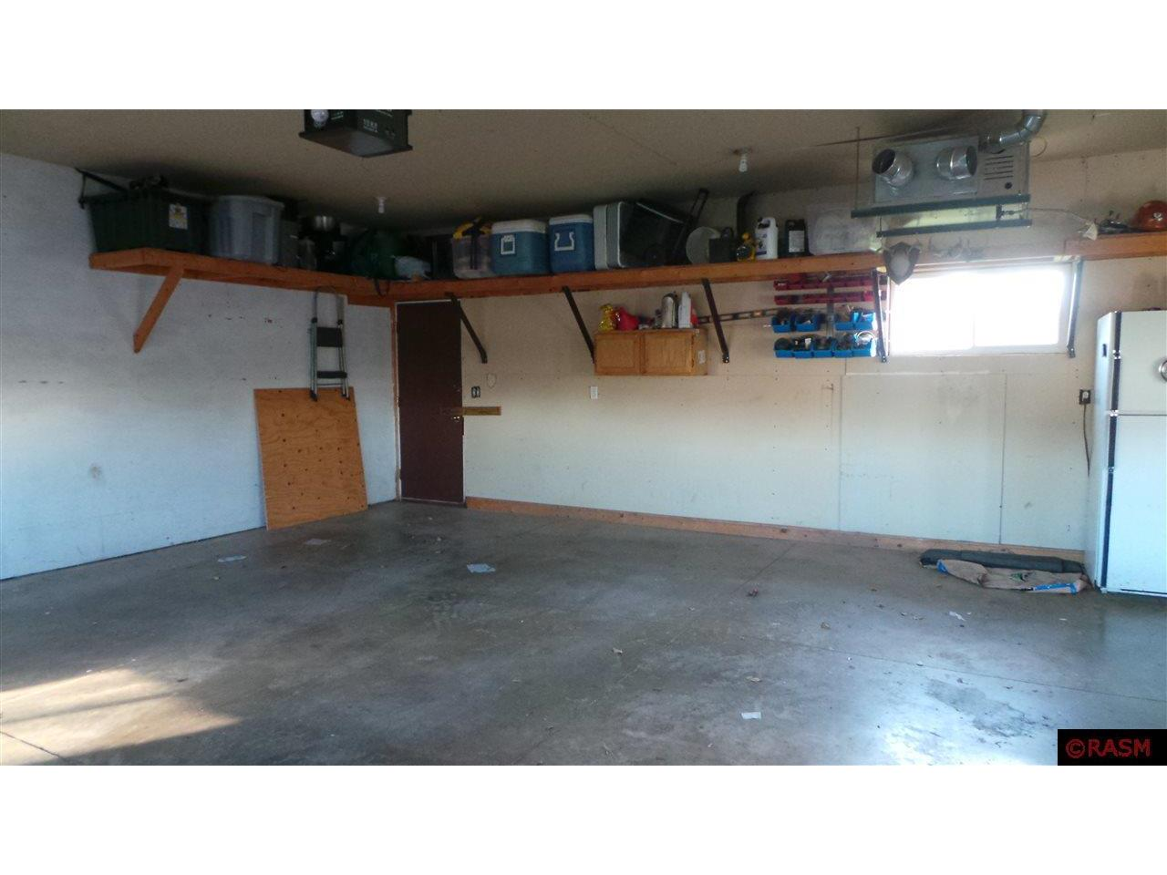 insulated and heated garage with new insulated garage doors.