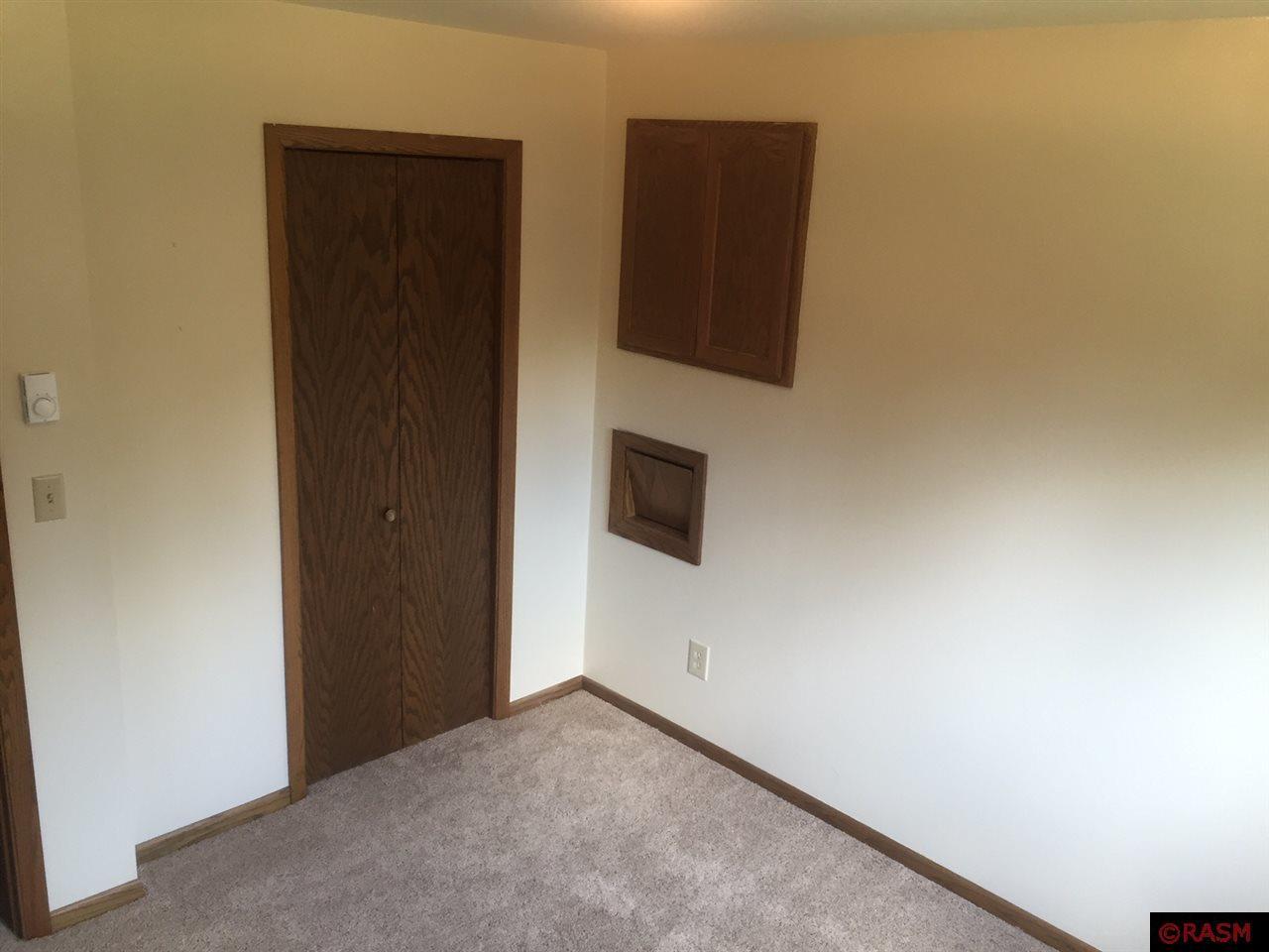 Upper level bedroom, laundry shoot, closet, access to attic.