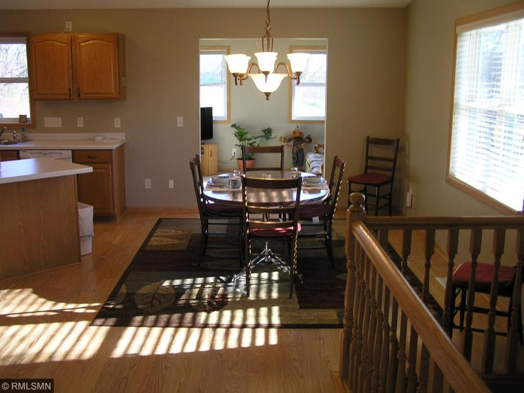 Open floor plan with large eating area, kitchen, living room opening into 4 season porch