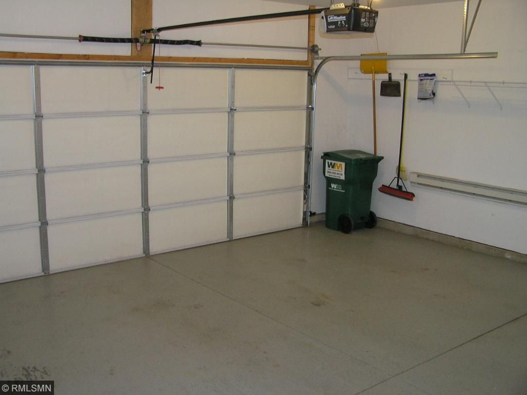 Finished, heated garage. Driveway is concrete and oversized