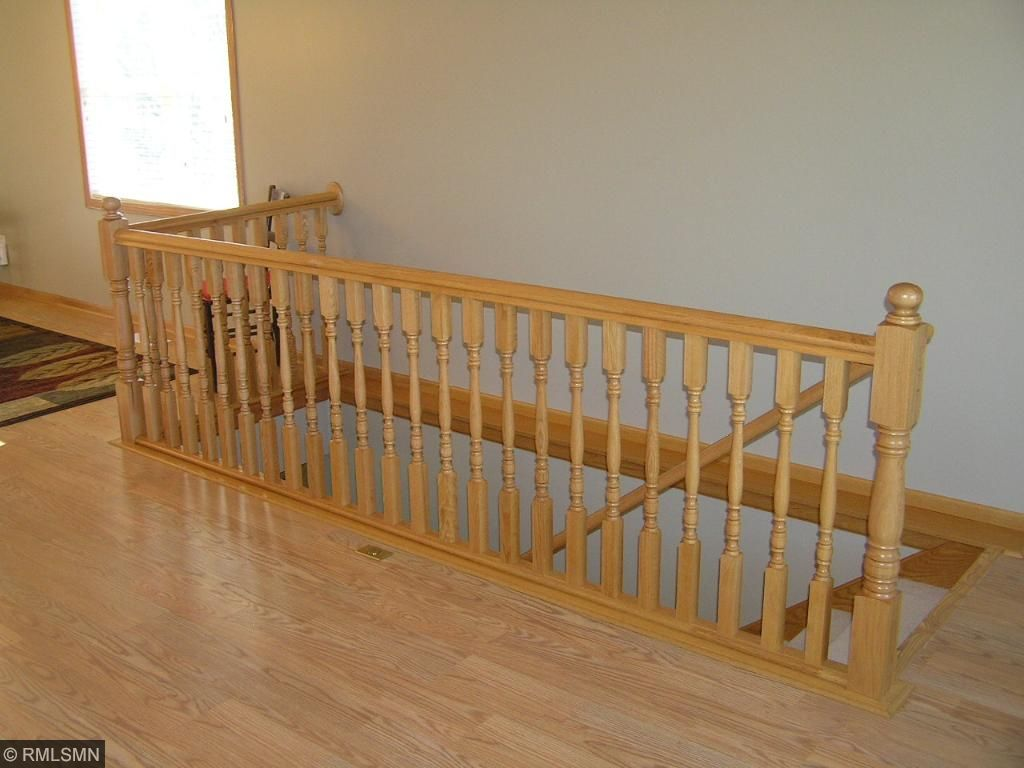 Oak open staircase to walkout level