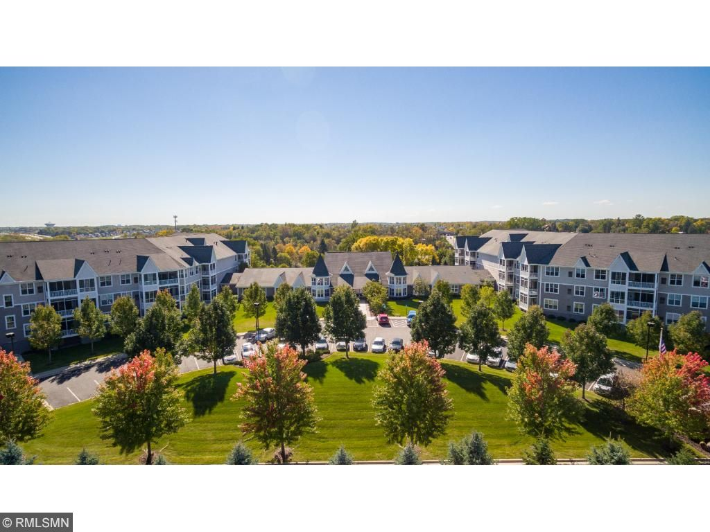 Welcome to Medina Ridge Condominiums! This sought after 55+ Community offers elegance, security and luxury. This Condominium comes with TWO storage units (most have one) and TWO garage stalls.