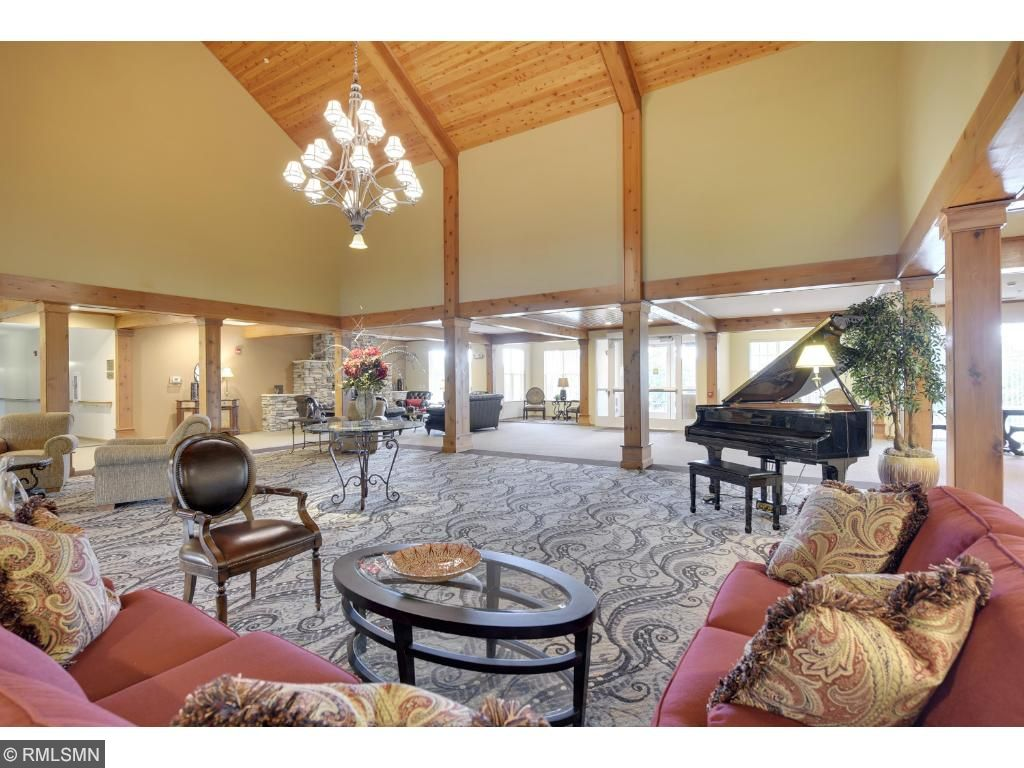 Common areas~Breath taking as you walk into this spacious foyer with soaring 9 ft. ceilings. An impressive grand piano offers a welcoming gathering area! Many events are held in this grand great room which has multiple alcoves and seating areas.