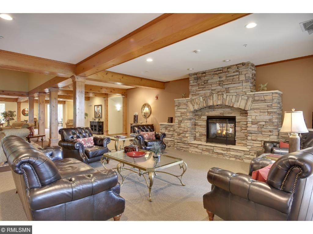 Common Areas~Enjoy the sitting area for reading or intimate conversations by this beautiful stone gas fireplace and views of the veranda complete this elegant and inviting space.