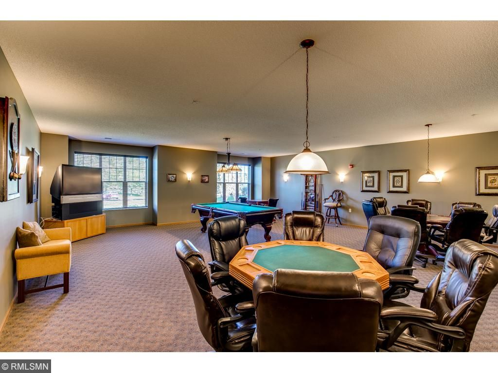 Common Area~Players Club/Entertainment Room-Want to play a game of poker or pool? Two game tables, dart boards, billiard table and a large screened TV.