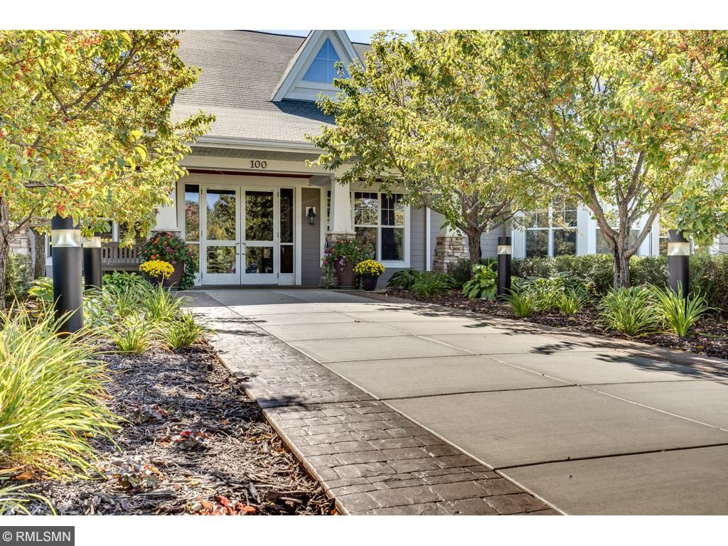 Grand entrance with beautiful flowers and professionally landscaped.