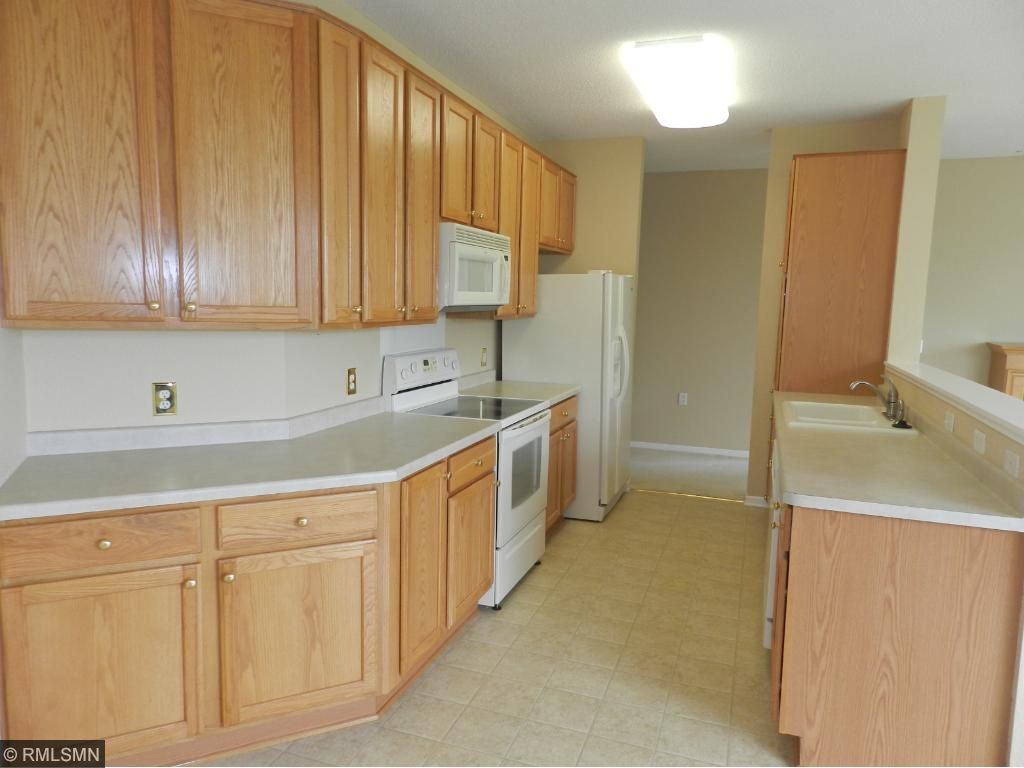 Beautiful open and bright kitchen with natural woodwork.  Move-In Ready!