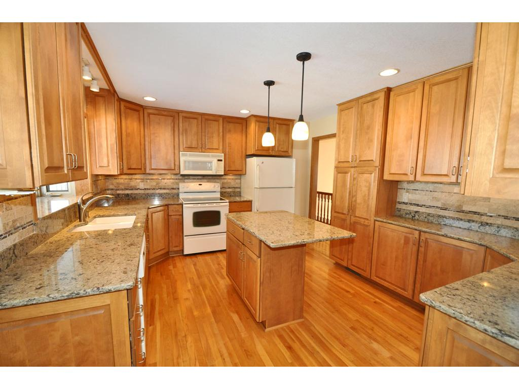 Custom Cabinetry And Cambria Counter Tops. Kitchen Looks Out At Beautifully  Landscaped Back Yard.