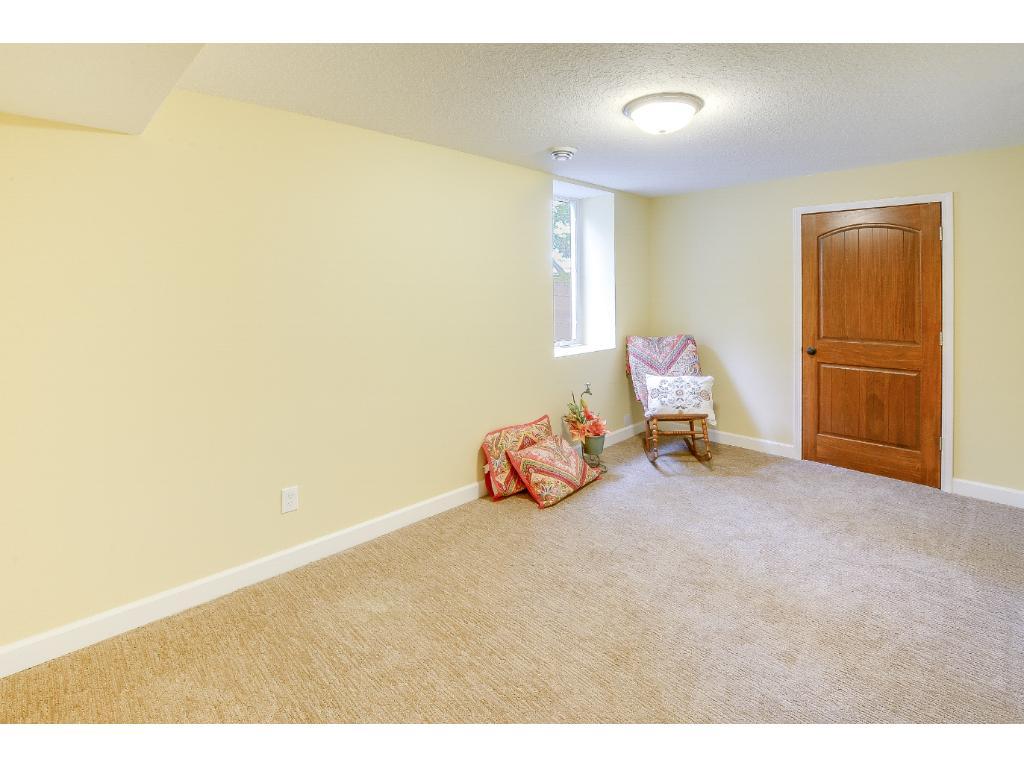 3rd bedroom with large egress window & huge walk-in closet.