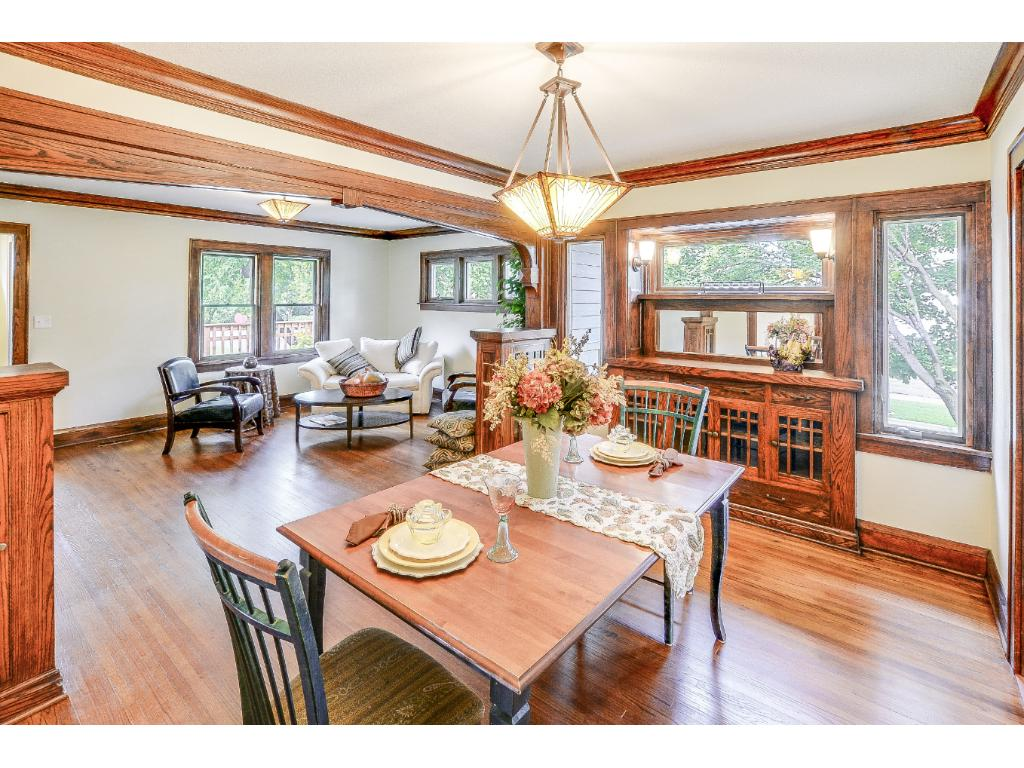 Gorgeous built-in buffet and bookcases surrounded by gleaming woodwork and hardwood floors.