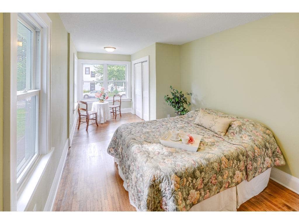 Charming sunlit master bedroom.