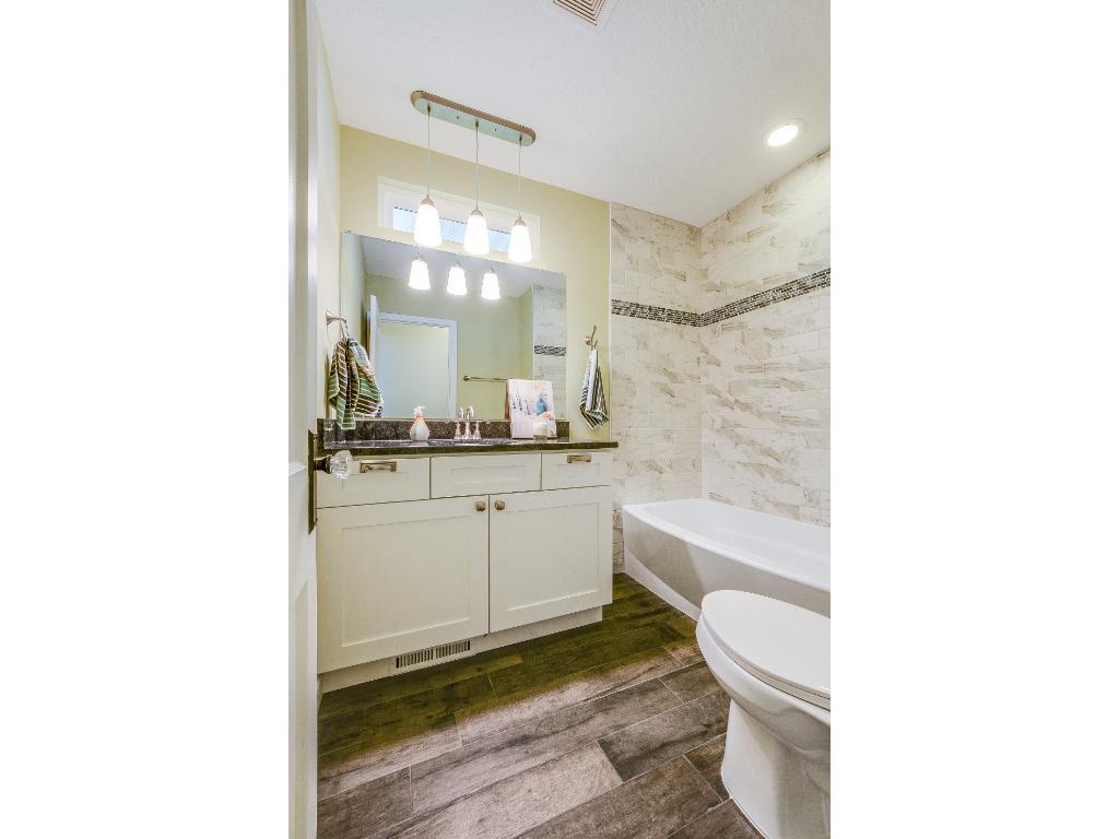 Freshly tiled brand new bathroom.