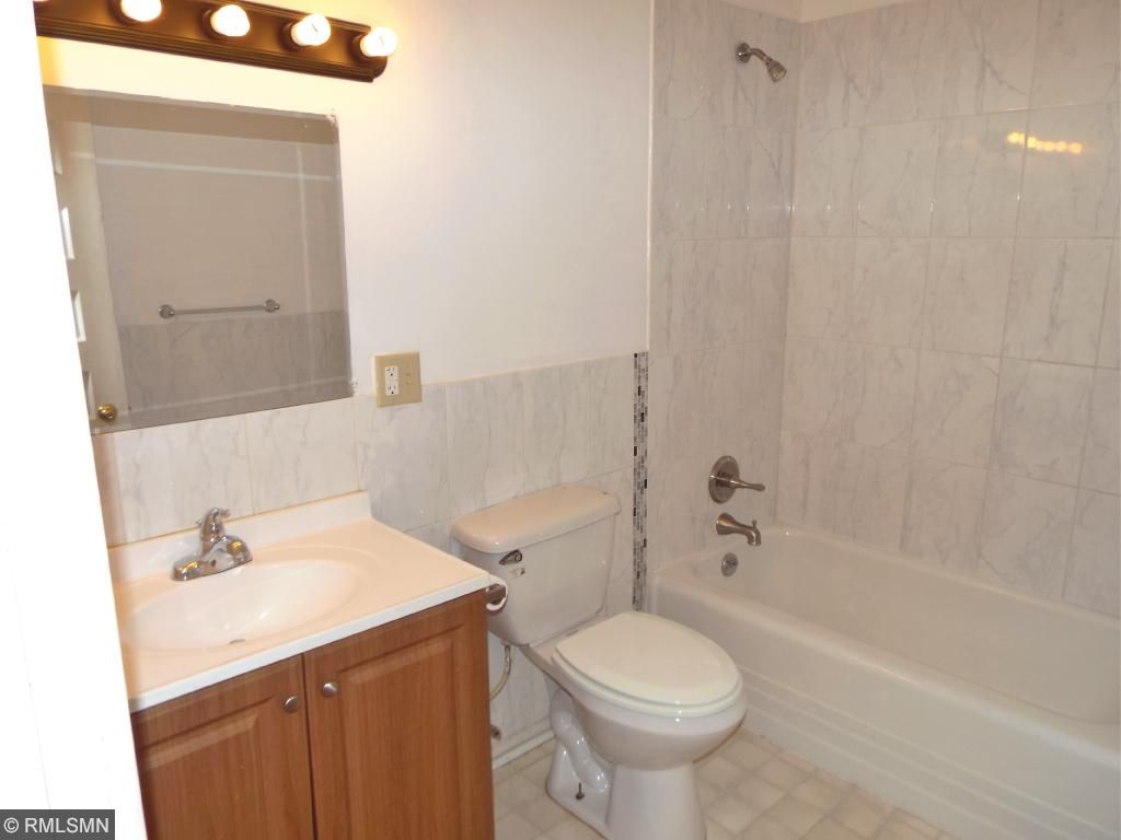 Marble tile in shower surround.