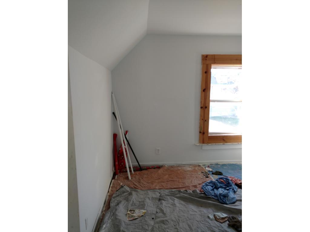 Bedroom has new paint.
