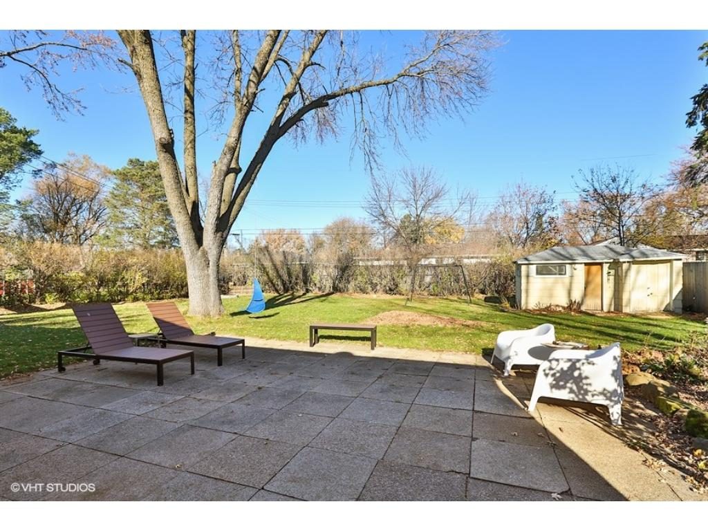 Great space for bbq's on this large patio! This fully fenced back yard is awesome for kids, pets and privacy! Storage shed, playhouse and lots of perennials!