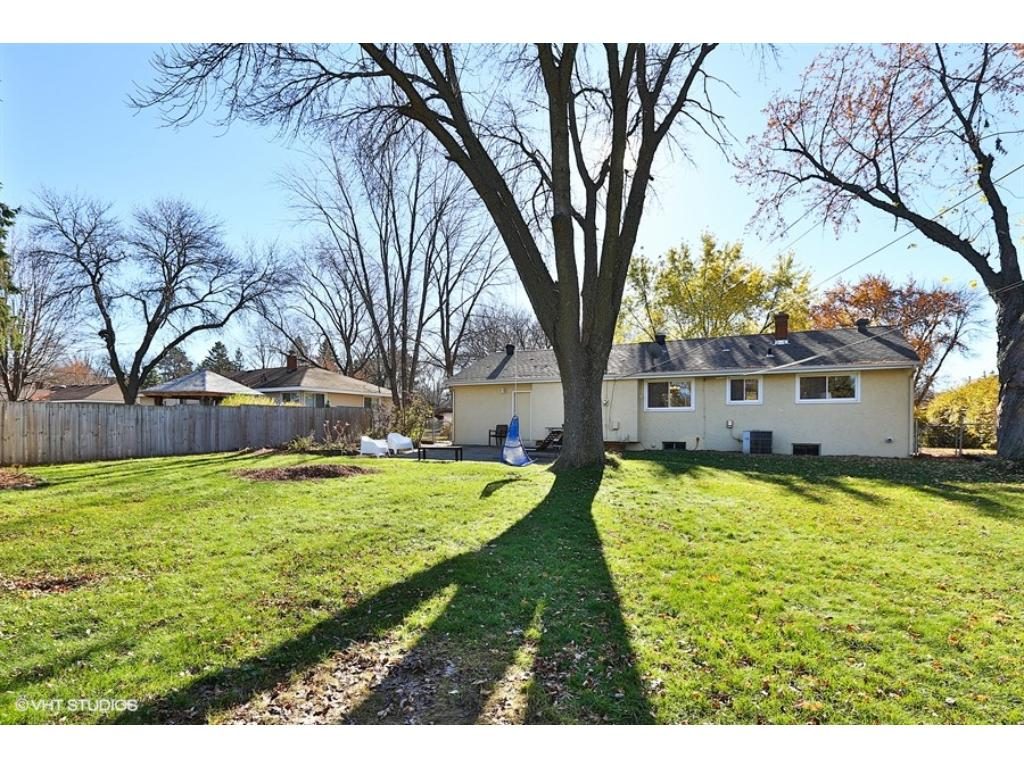 Spacious back yard and mature trees! Fully fenced!